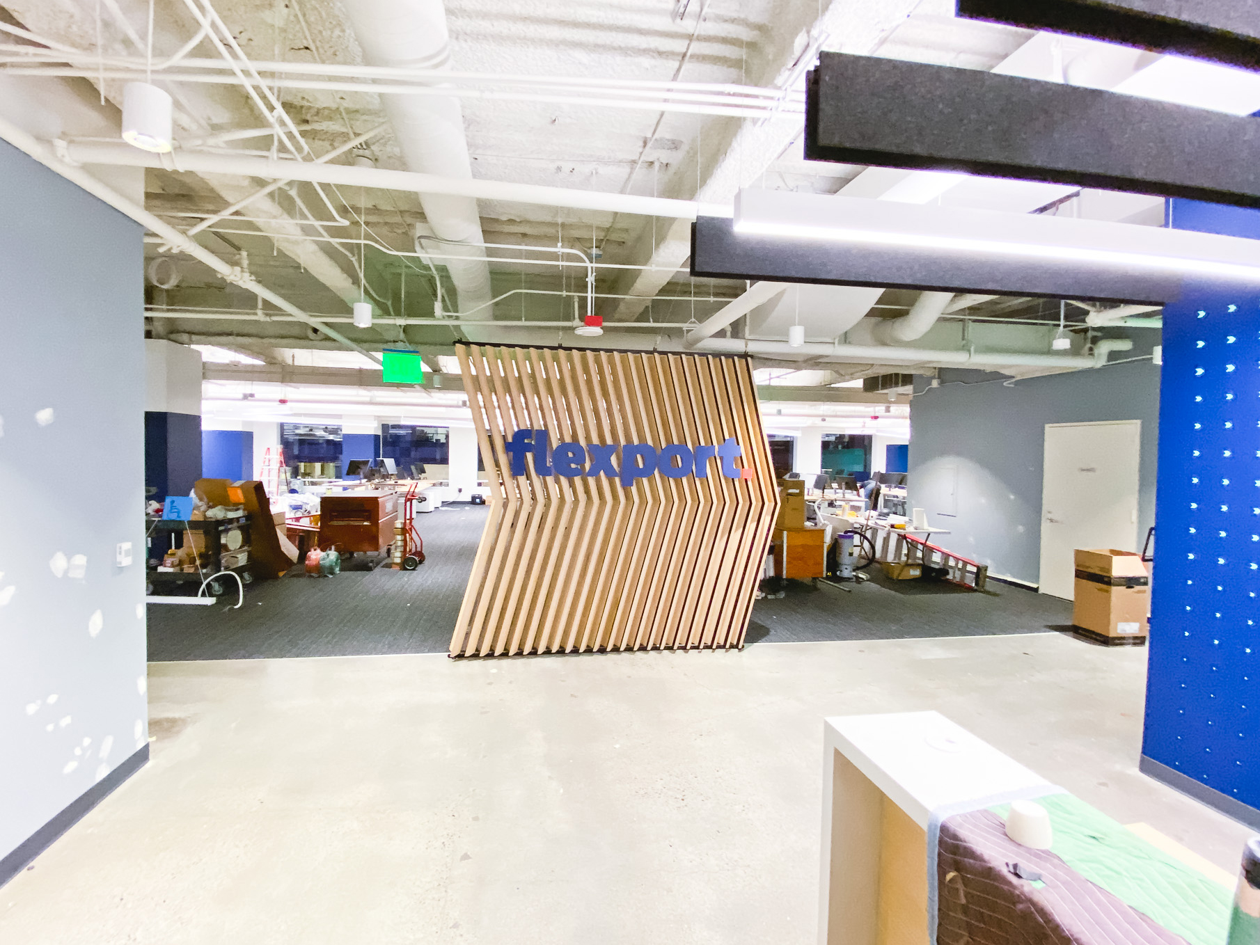 Slat wood divider wall installation for Flexport, a freight forwarding and customs brokerage company based in San Francisco, California.