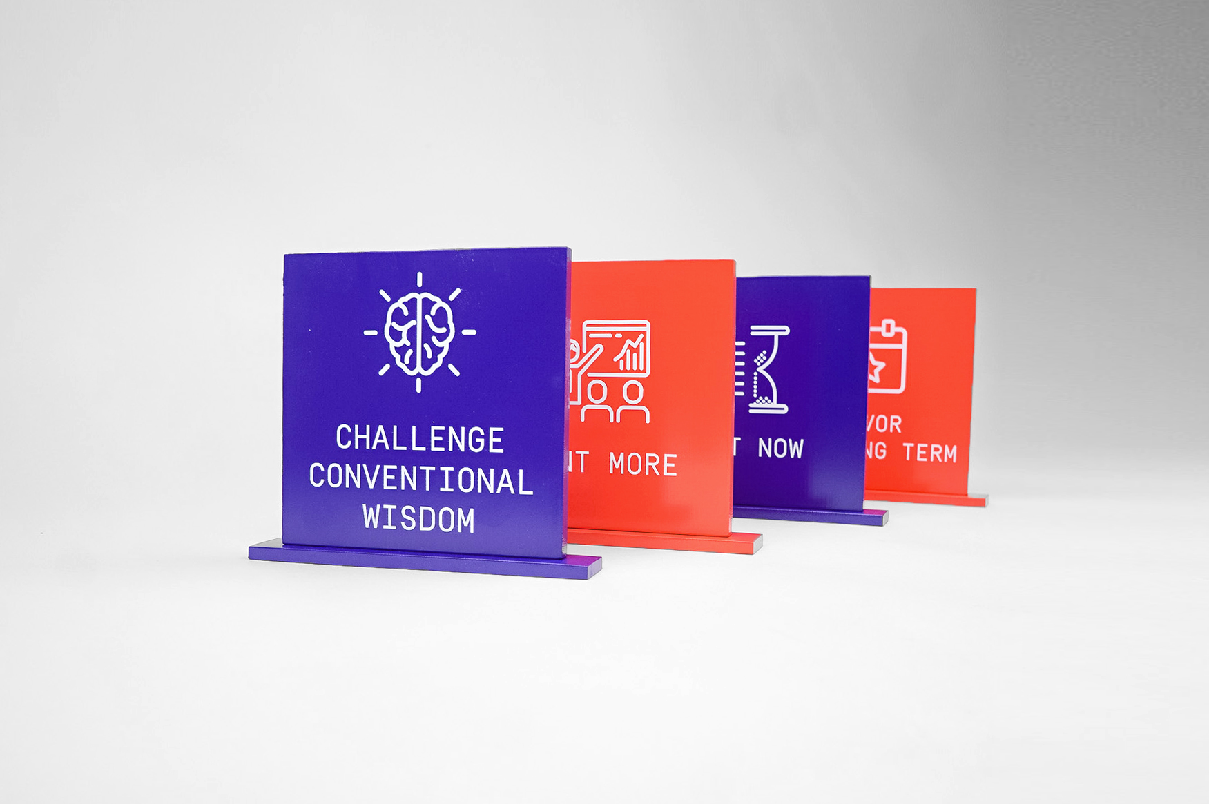 Red and purple painted tabletop company value plaques for the San Francisco office of Gong, makers of a conversation intelligence platform for sales.