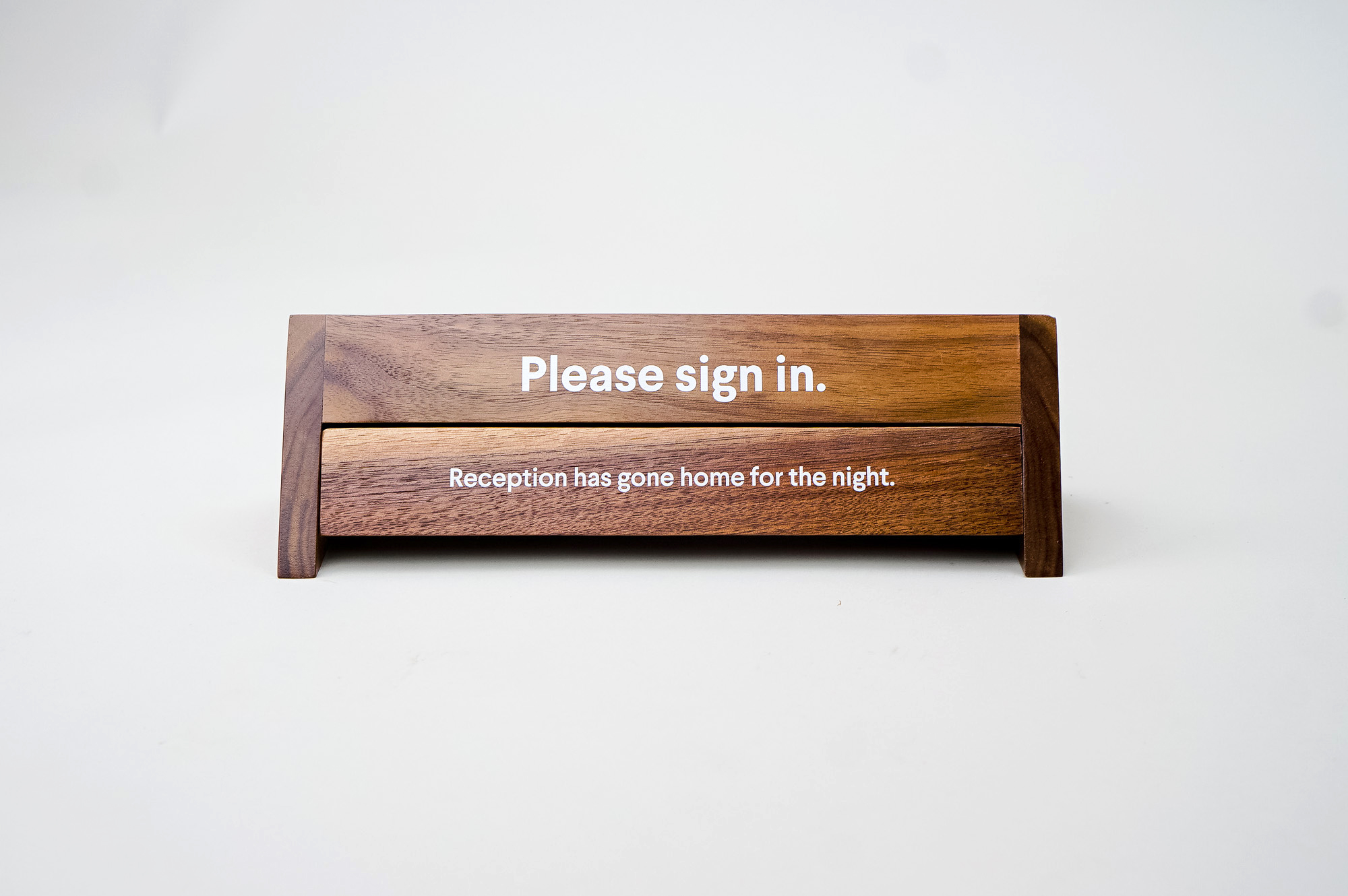 Rotating wood reception sign with various away messages for Slack, an American cloud-based set of team collaboration tools and services.