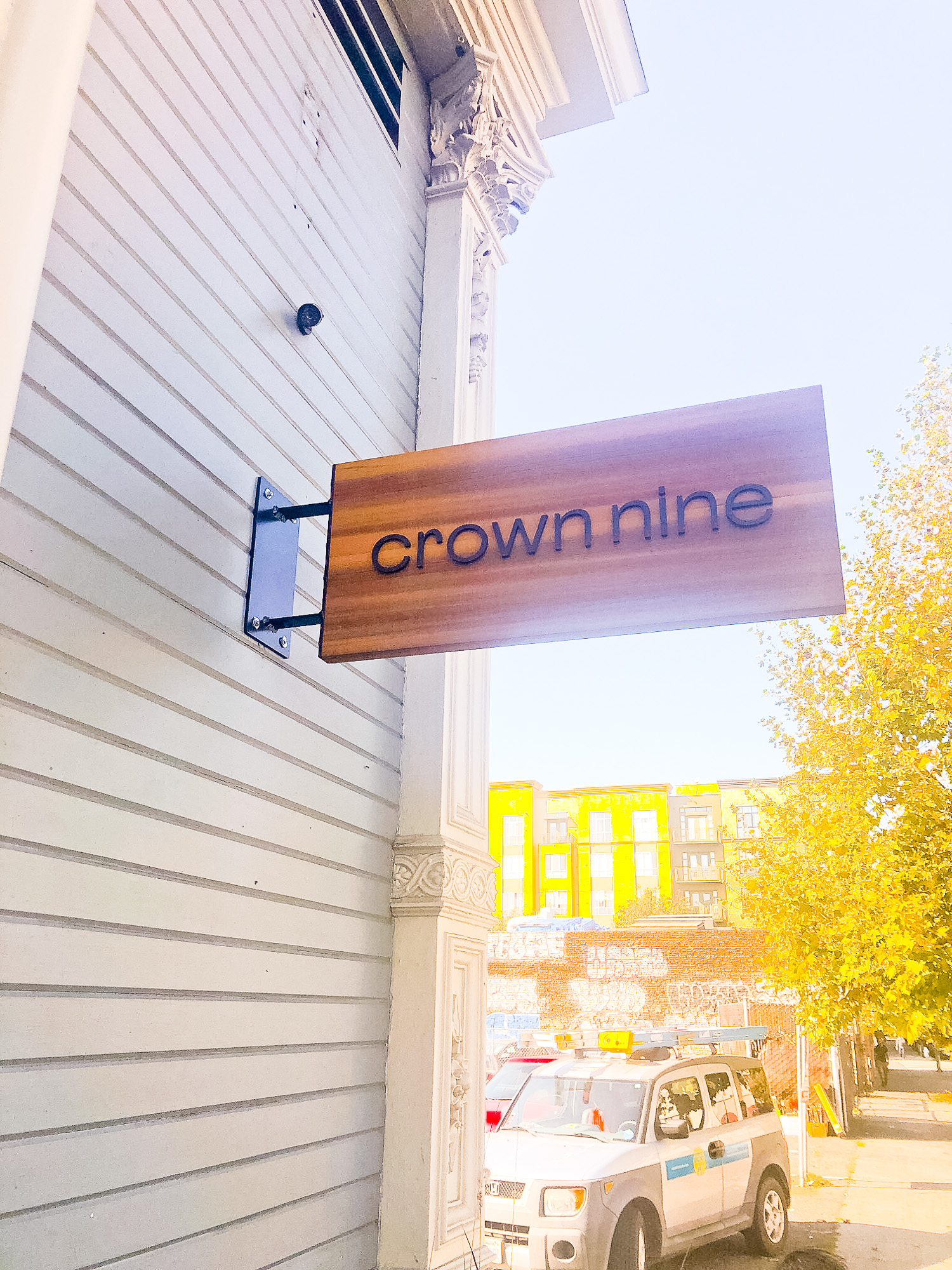 Minimal cedar blade sign for Crown Nine, a jewelry boutique of award winning jewelry artist Kate Ellen in the heart of historic Old Oakland.