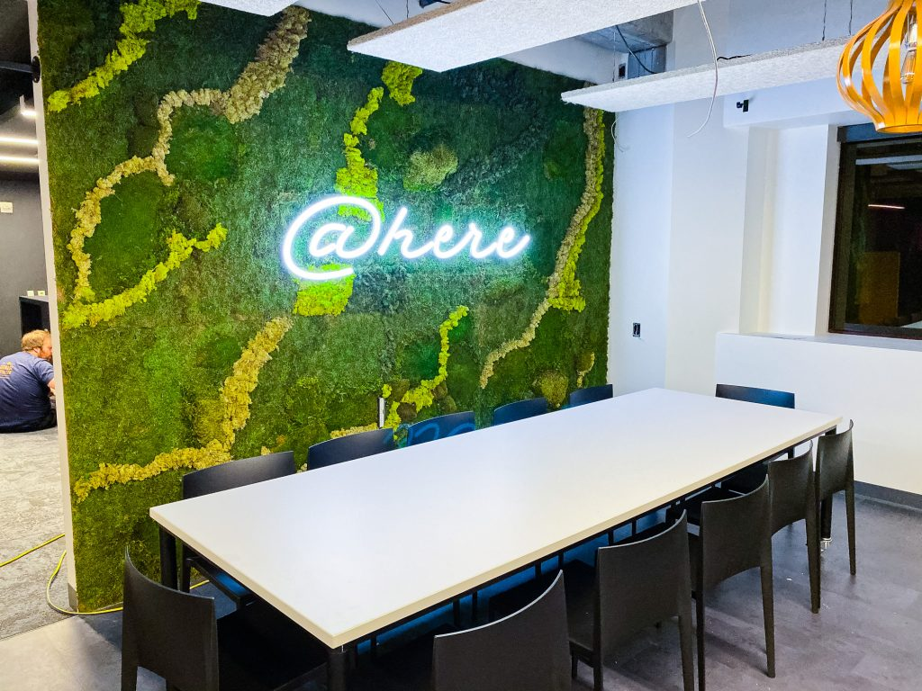 Neon-style @here sign on moss / living wall for the cafeteria/kitchen of Scale, a San Francisco based company delivering high quality training data for AI applications such as self-driving cars, mapping, AR/VR, robotics, and more.