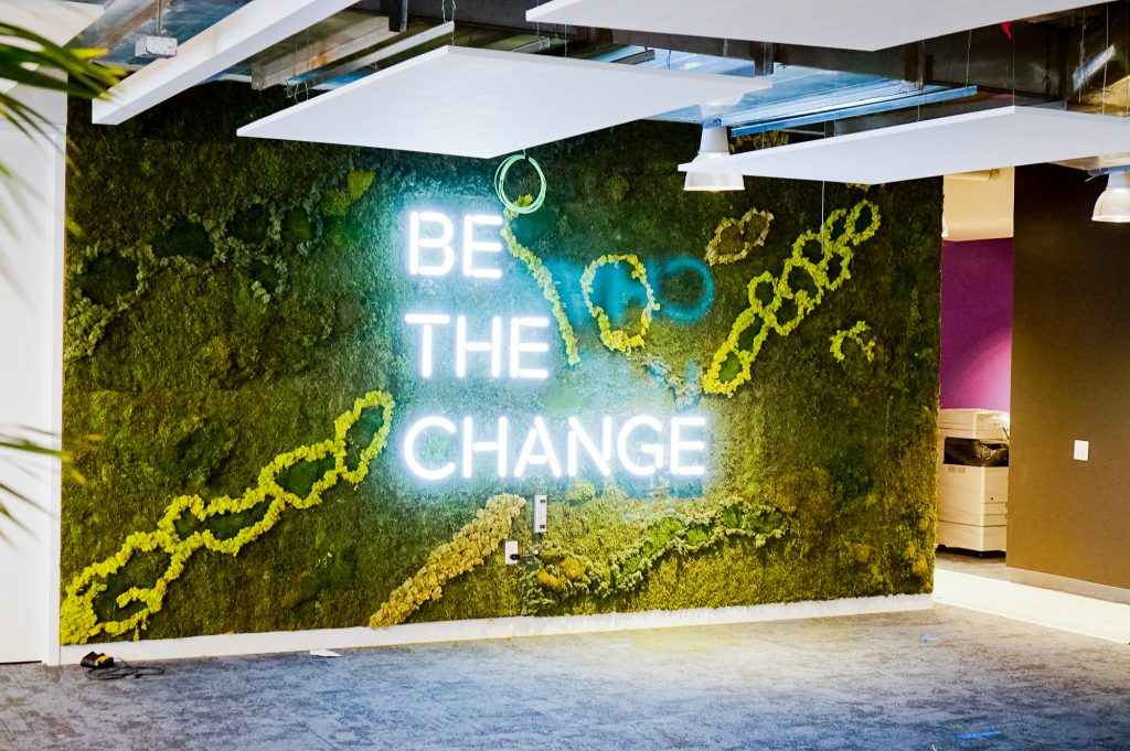 """Neon-style, motivational """"be the change"""" sign on a large moss / living wall for Scale, a San Francisco based company delivering high quality training data for AI applications such as self-driving cars, mapping, AR/VR, robotics, and more."""