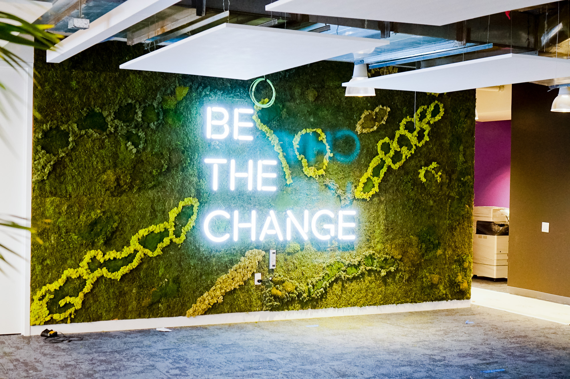"Neon-style, motivational ""be the change"" sign on a large moss / living wall for Scale, a San Francisco based company delivering high quality training data for AI applications such as self-driving cars, mapping, AR/VR, robotics, and more."