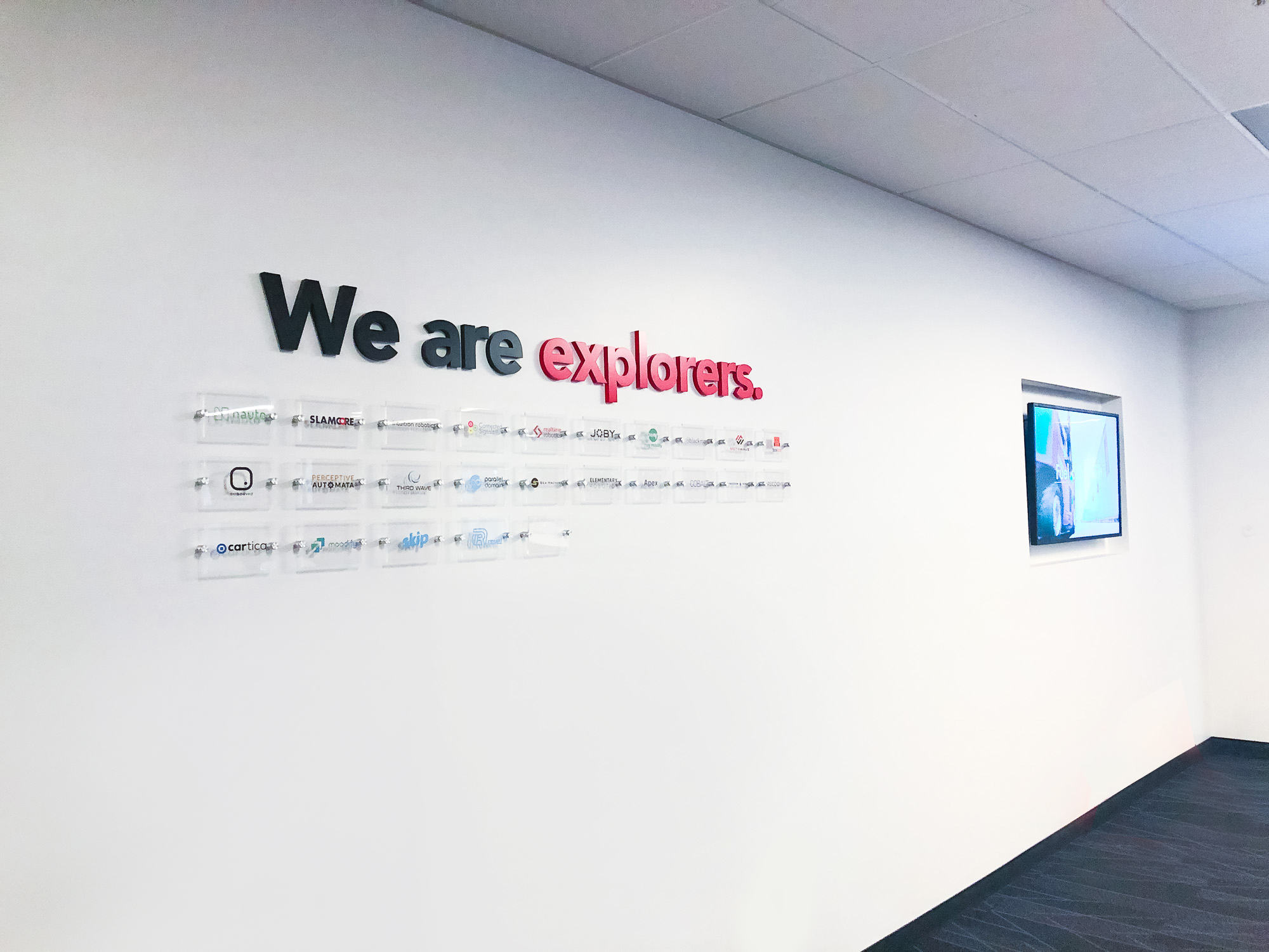Mission statement and portfolio company logo wall for Toyota AI, a new venture capital subsidiary of the Toyota Research Institute.