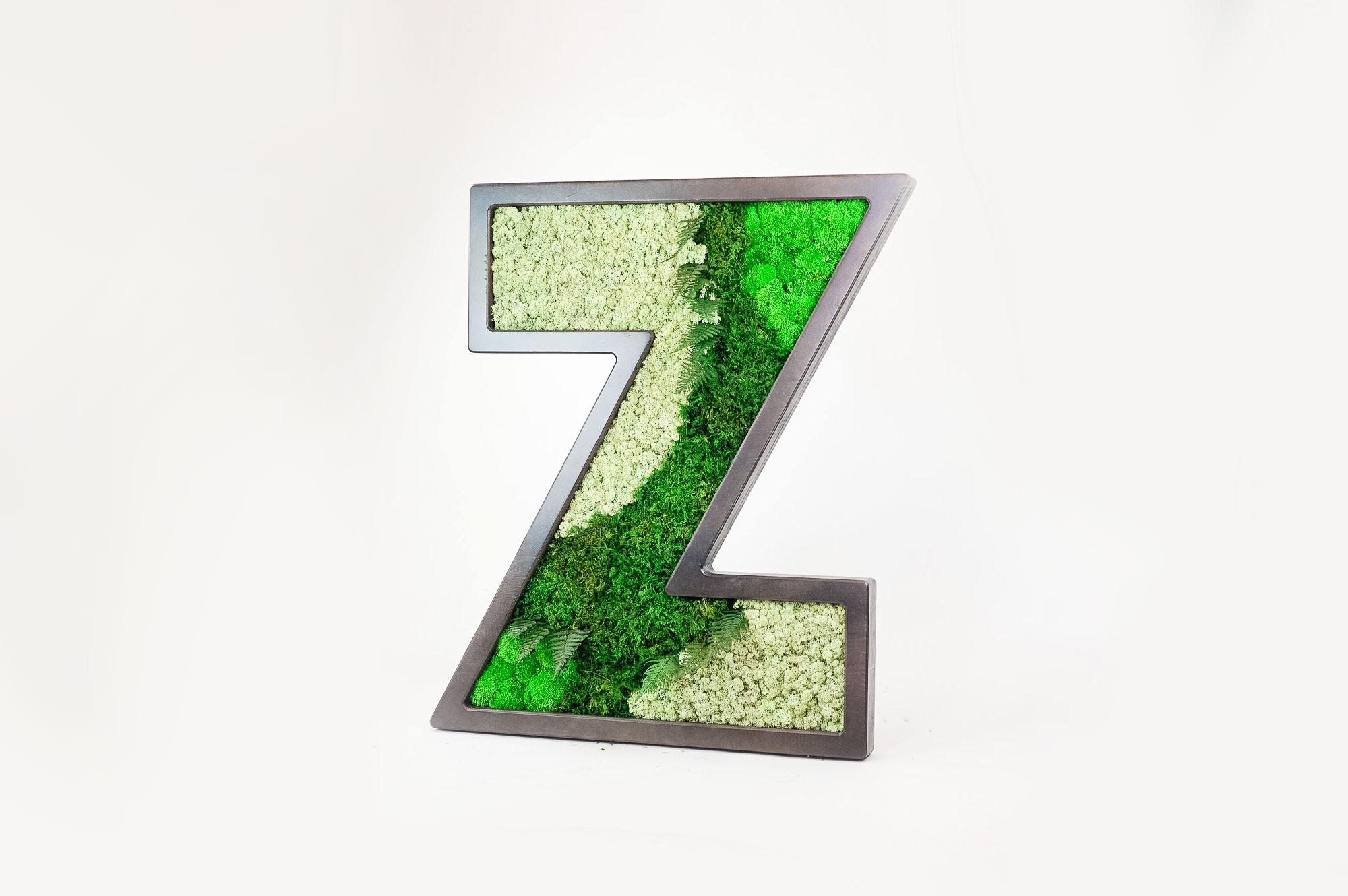 Dark wood letter filled with preserved moss art for Zumper, a full-service rental platform.
