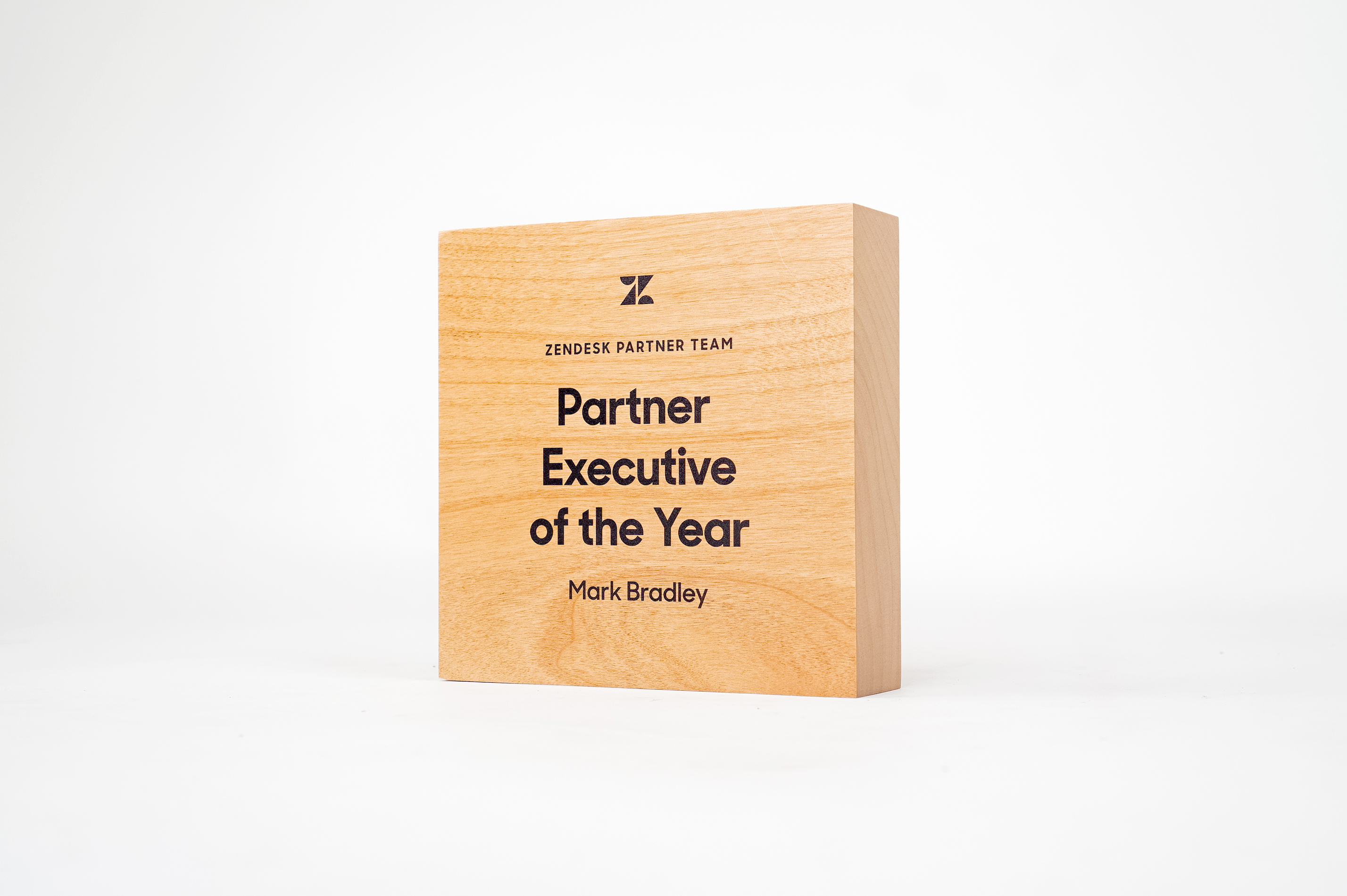 Simple, solid light wood, executive of the year award for Zendesk, a customer service software company headquartered in San Francisco, California.