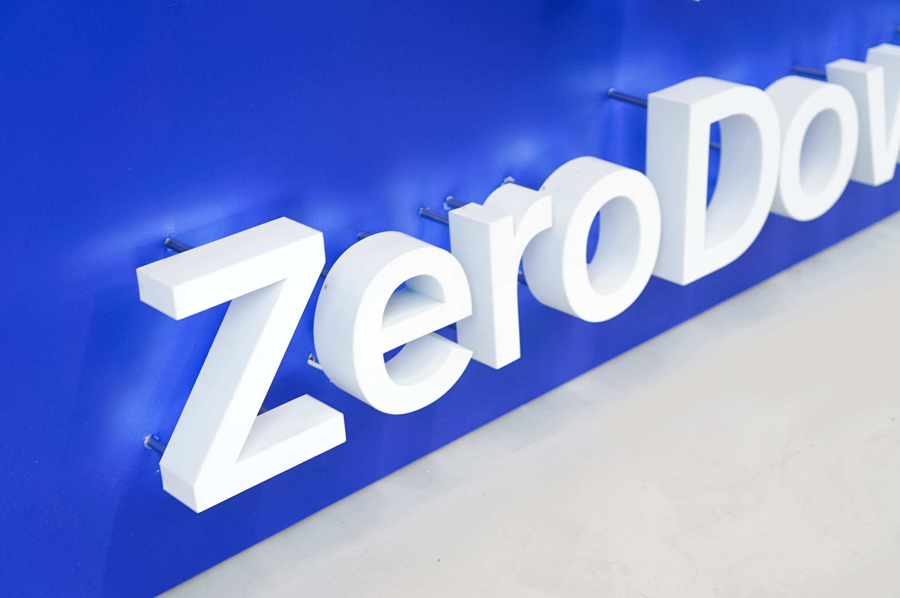 Back-lit, illuminated blue and white lobby sign for Zerodown, a company that couples technology and a debt-fueled real estate fund to allow home-buyers to forgo the traditional down payment process required to purchase a home.
