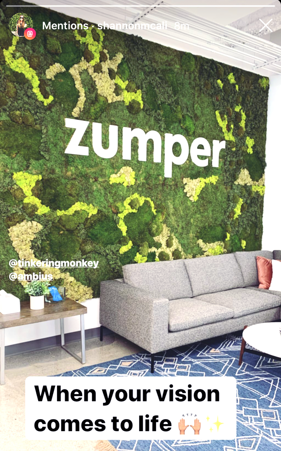 White letters on moss art wall for the lobby of Zumper, a full-service rental platform.