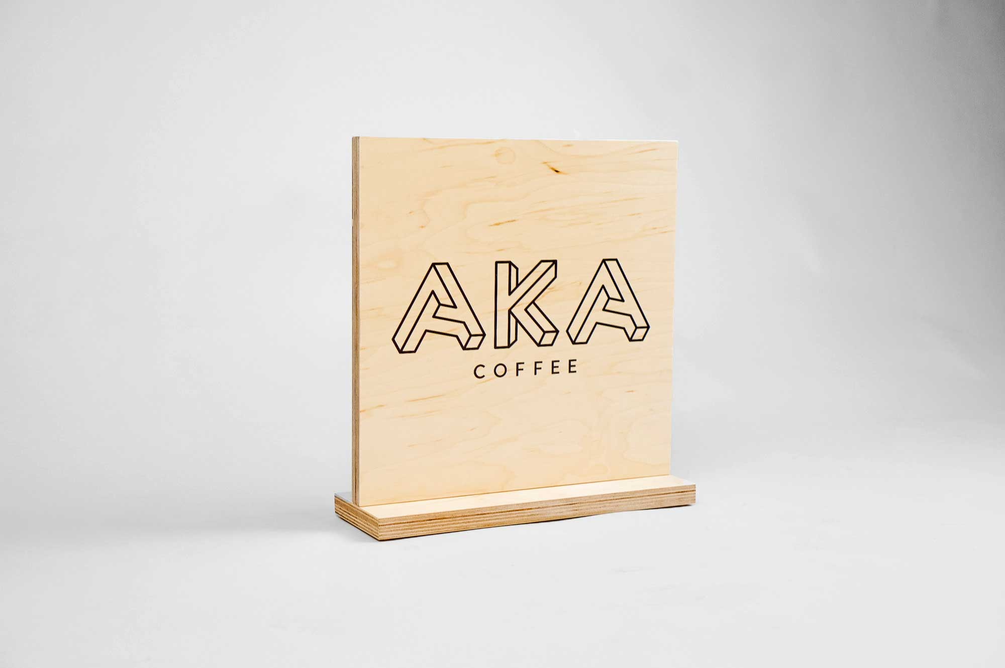 Wood tabletop sign for coffee popup at Square headquarters for AKA coffee, a coffee roastery based out of Oakland, CA.