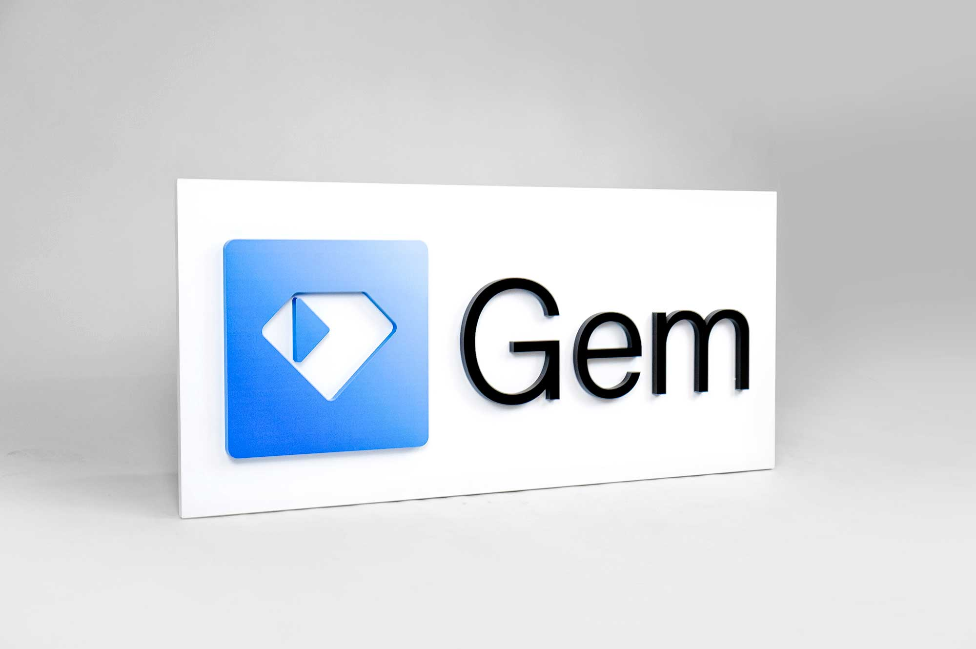 Blue gradient logo with black text on white backer board for Gem, a San Francisco based company creating all-in-one recruiting platform.