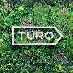 White dimensional logo on Vistagreen living wall for the lobby of Turo, an American peer-to-peer carsharing company.