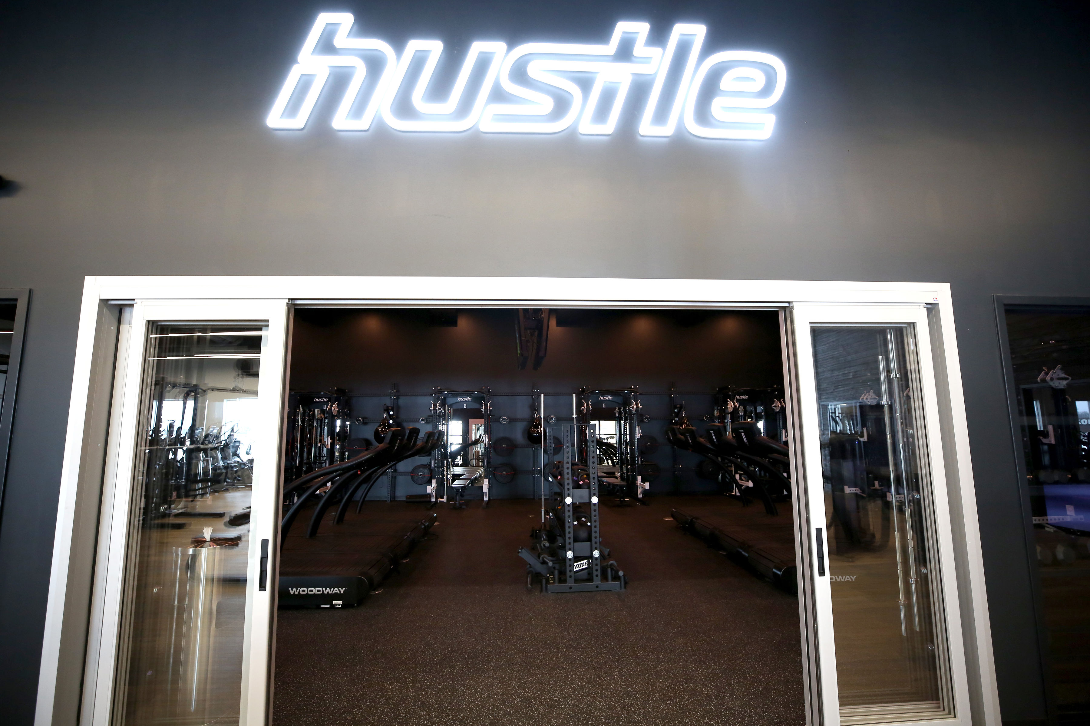 Neon style sign for Hustle, a strength and cardio studio inside Styles Studios, a fitness club in Peoria, IL.