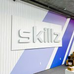 Illuminated metal sign for the reception desk at the San Francisco office of Skillz, an online mobile multiplayer competition platform.