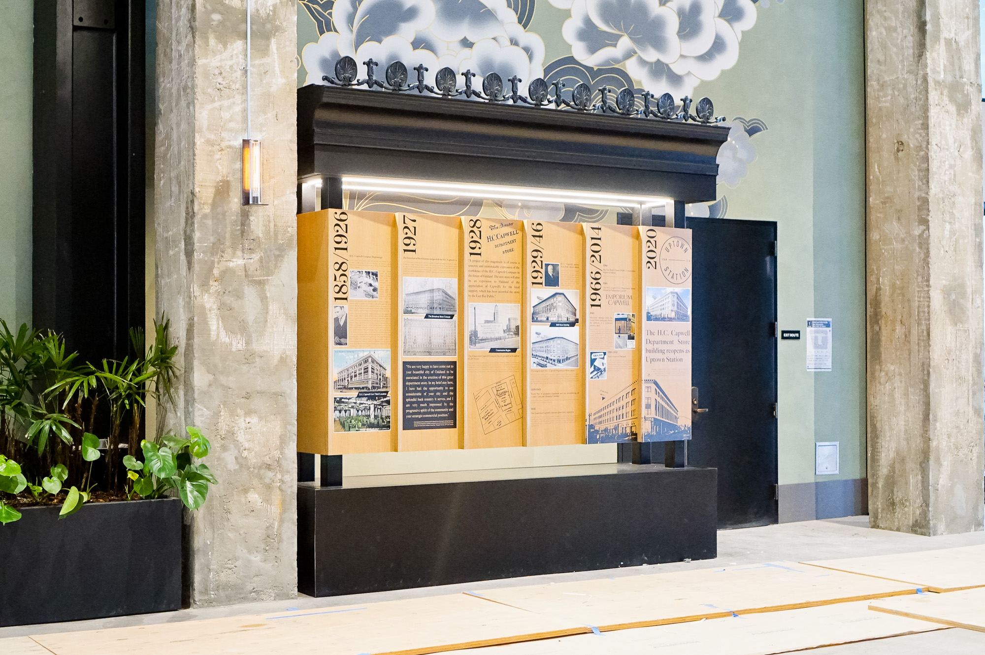 Wood/mixed media dimensional timeline display in the lobby of Uptown Station, an office and retail complex in a restored historic building located in downtown Oakland.