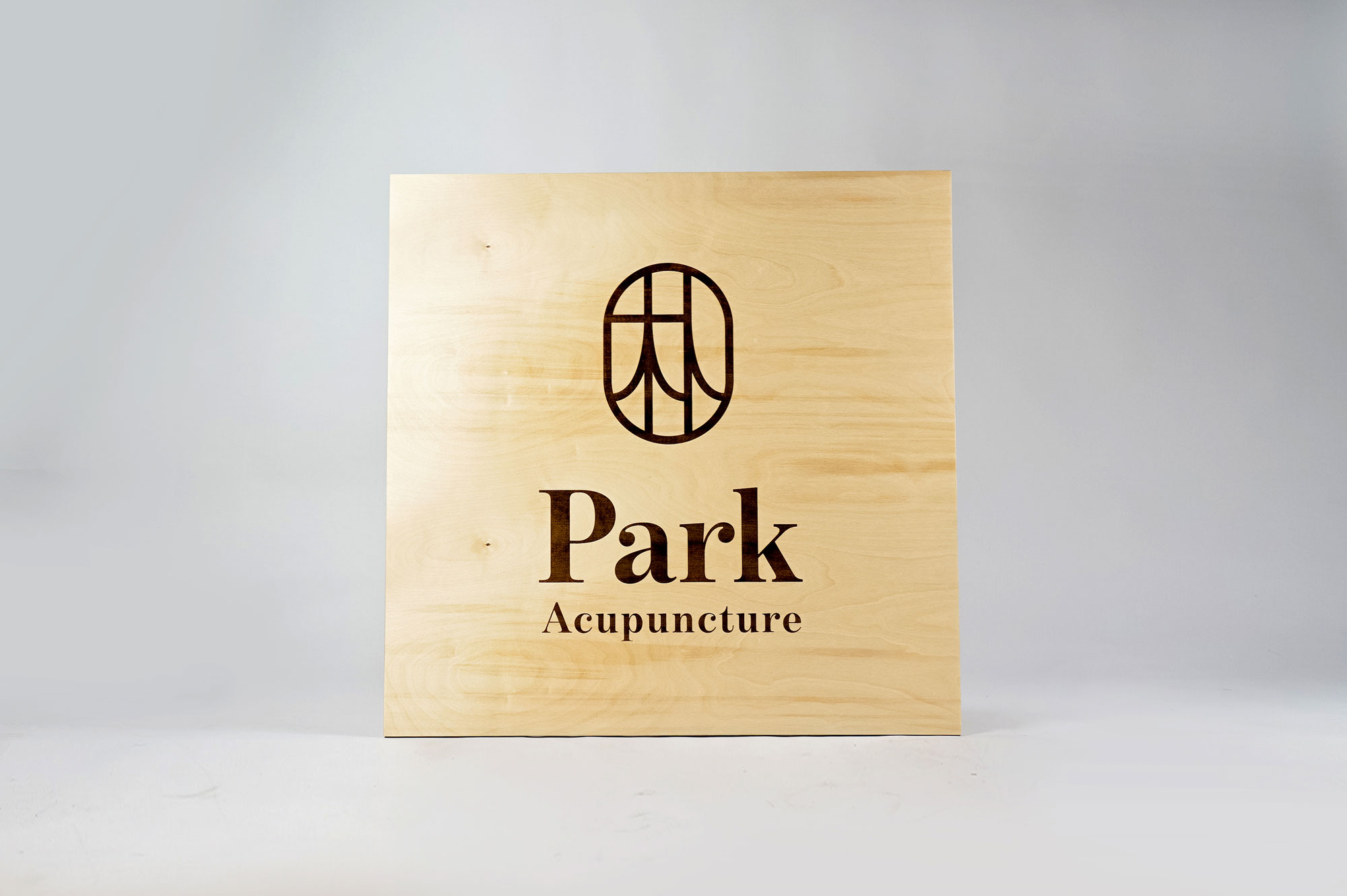 Laser etched/engraved square plywood sign for Park Acupuncture, an acupuncture clinic in Westwood, NJ.