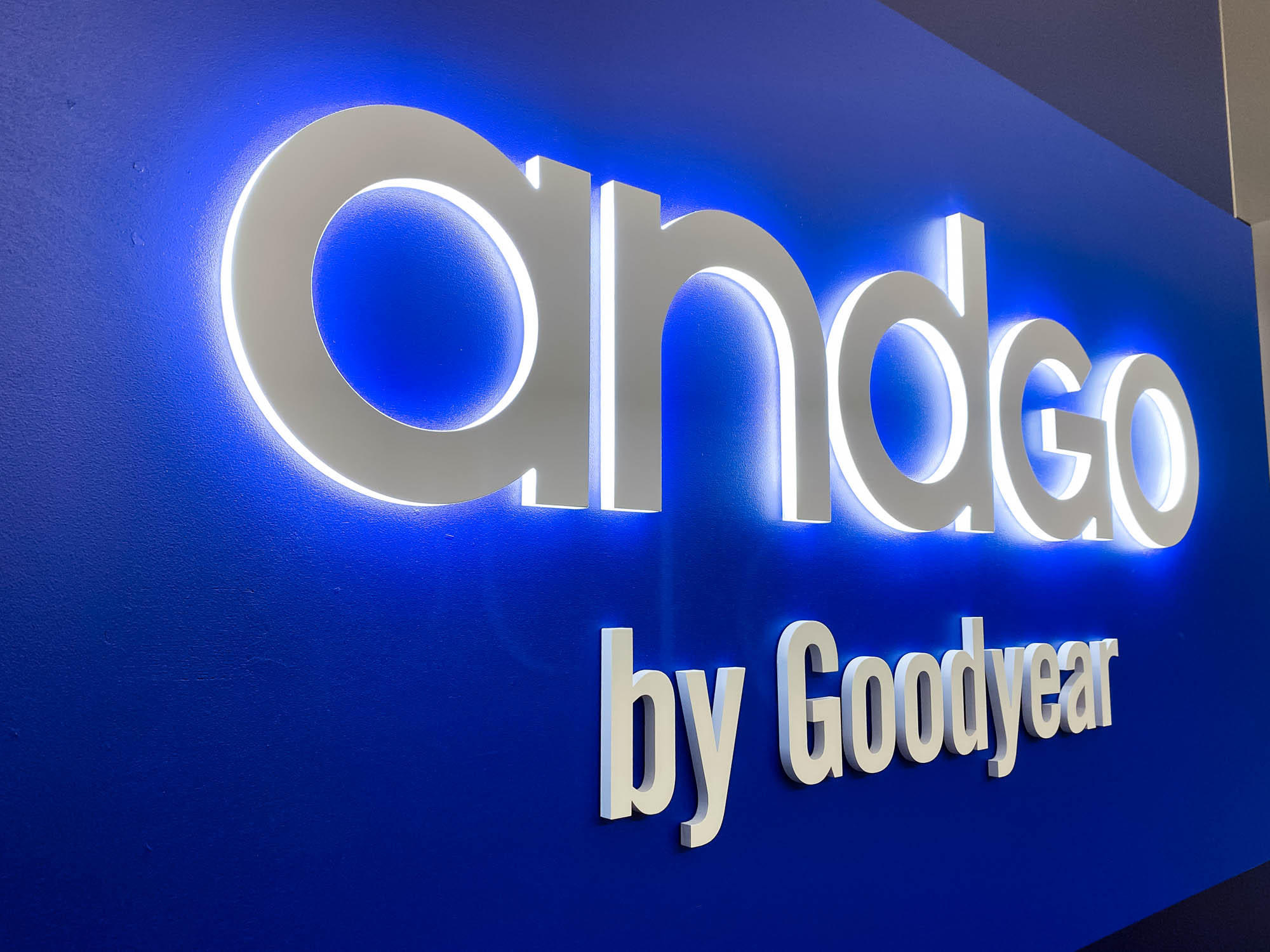 Illuminated, blue, edge-lit sign for the San Francisco office of andgo by Goodyear, a seamless vehicle-servicing platform designed to help consumer fleets monitor their service needs and improve their scheduling.