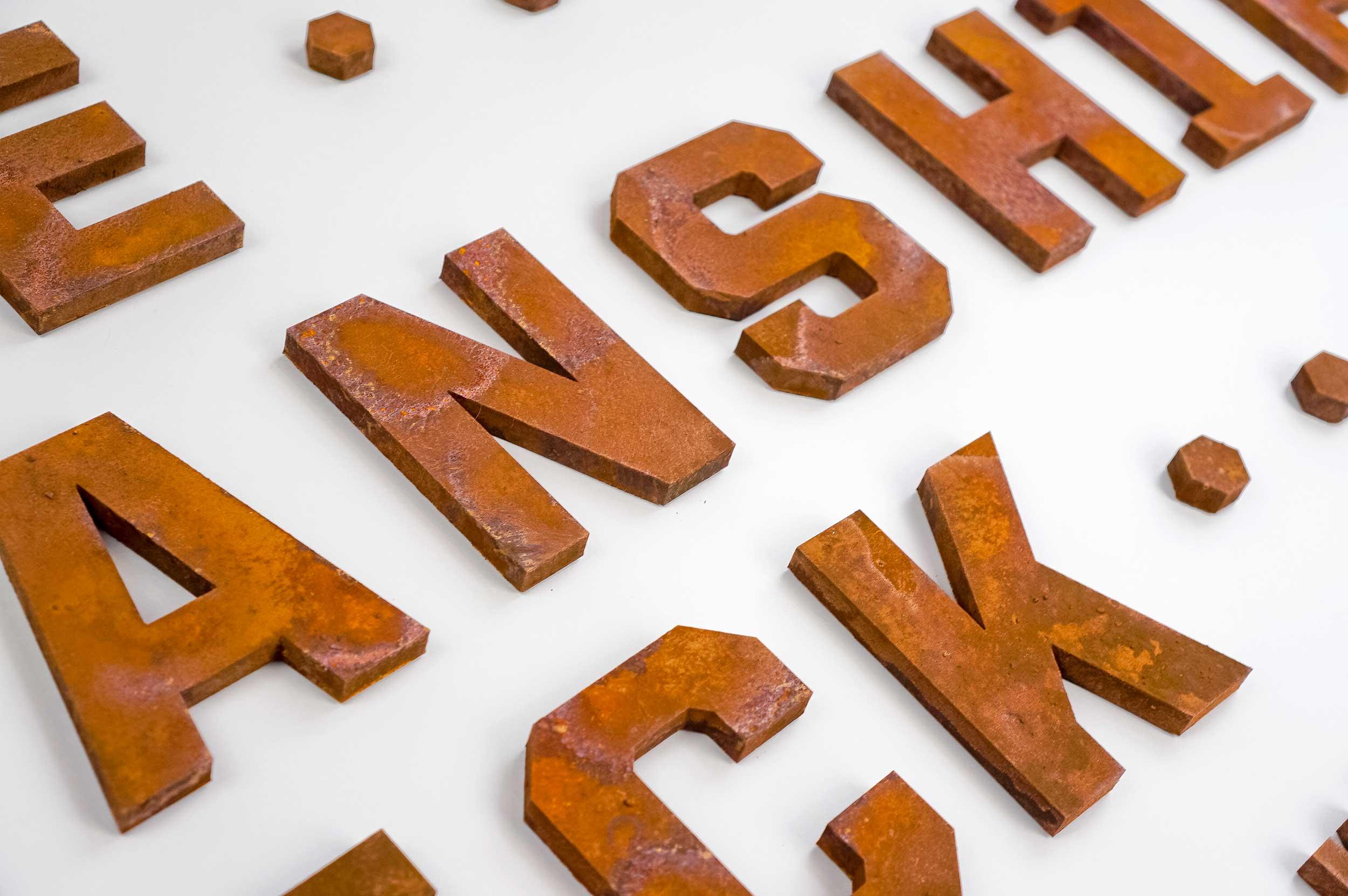 Faux rusty metal letters for the USS Kidd Veterans Museum in Baton Rouge, LA.