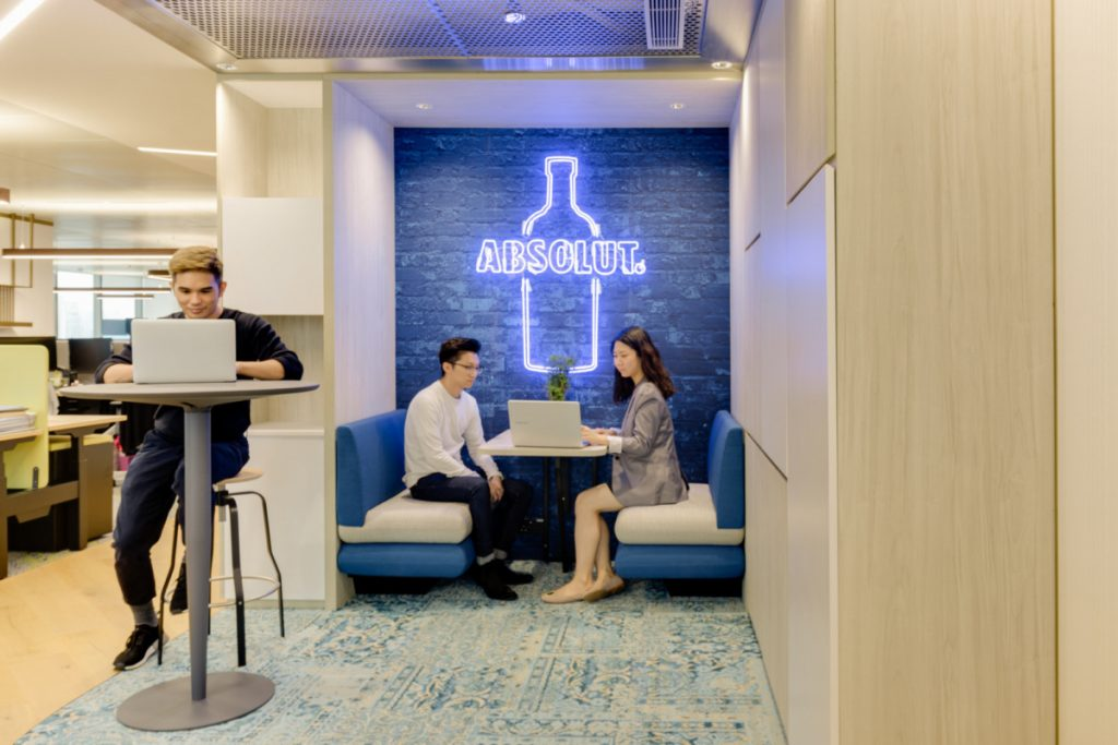 Blue neon Absolut vodka sign in office booth seating at the Pernod Ricard Offices in Hong Kong. (Photo: Harold de Puymorin)