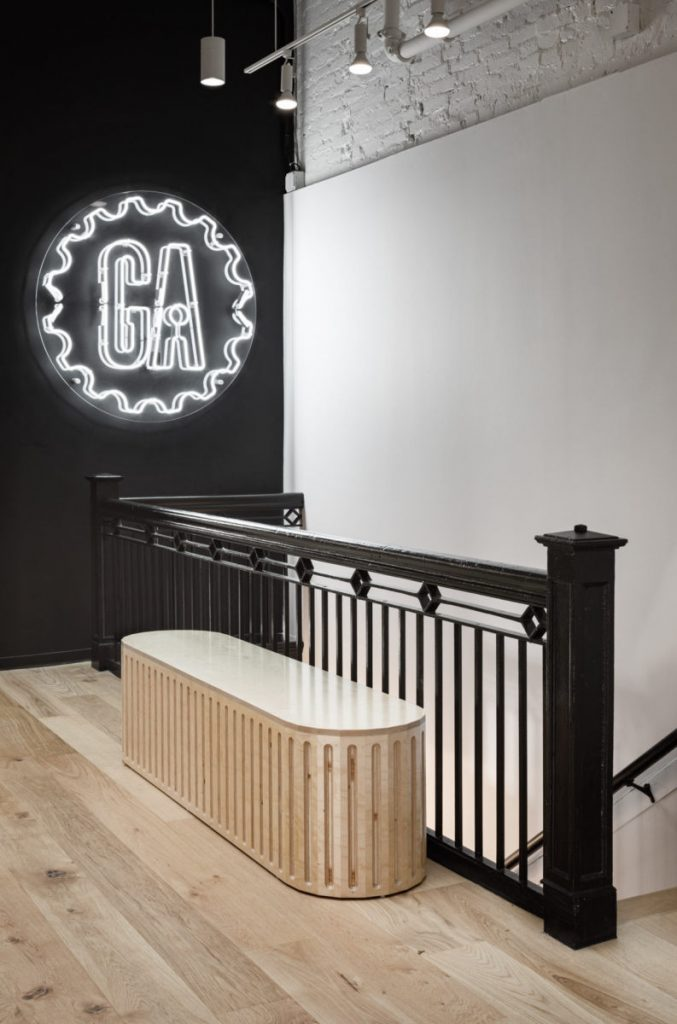 White neon sign with clear backer in black painted wall at the General Assembly headquarters in Washington DC. (Photo: Trent Bell)