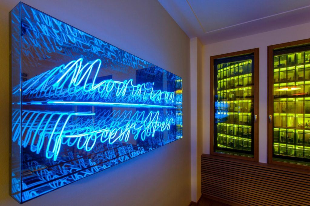 Blue neon on mirrored backdrop for the office of Morrison Forester in Berlin, Germany. (Photo: Asaf Oren)