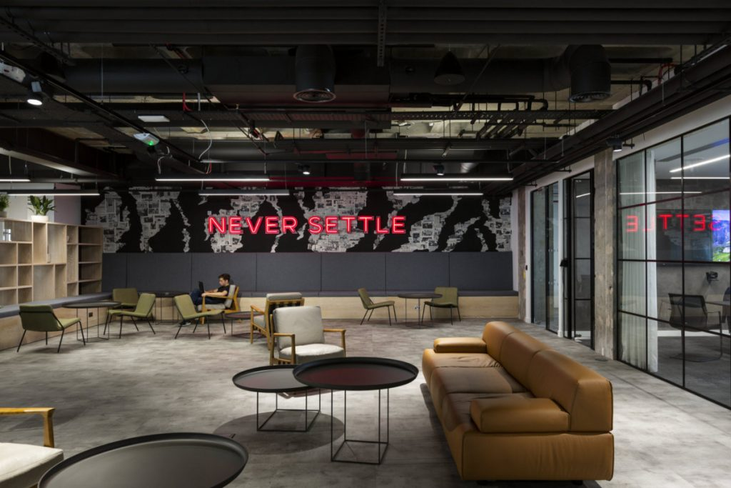 Red neon in channel letters on black breakout space office wall. (Photo: Tom Fallon)