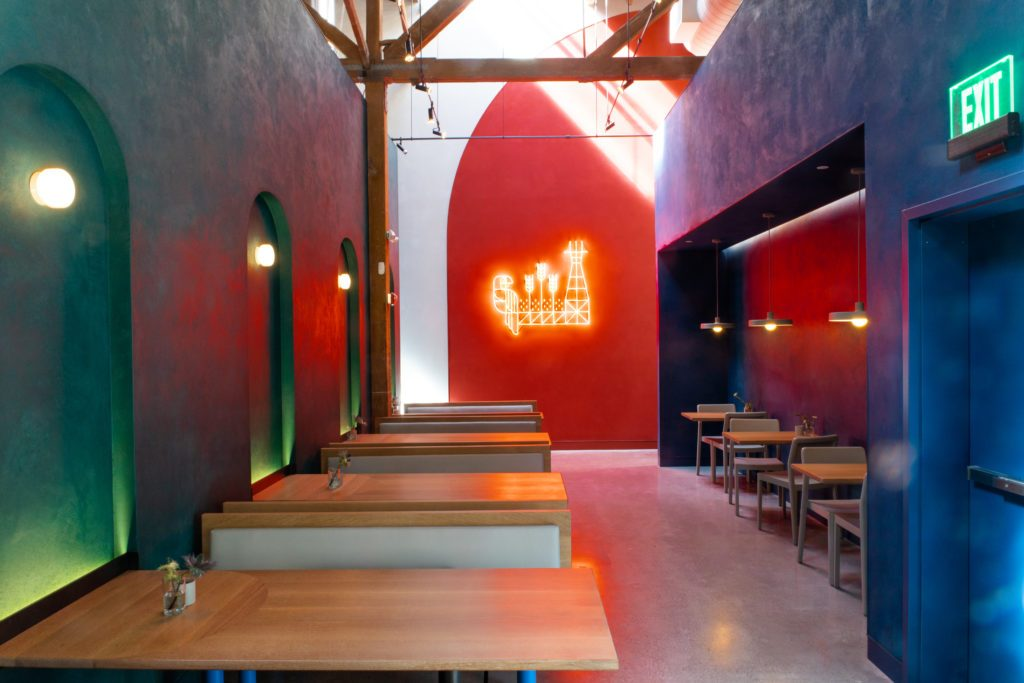 Red neon artwork on red wall for the entrance of Fort Point Brewery in San Francisco, CA. (Photo: Mariko Reed)