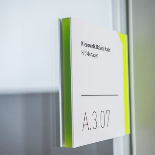 Modern white room sign with neon reveal, designed by Blank Studio for The Silesian Musuem in Katowice.
