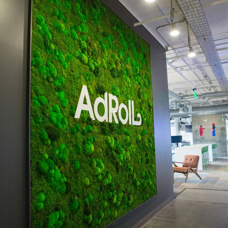Moss wall with white logo at AdRoll