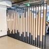 Custom slat wood and metal divider wall for the San Francisco office of Asana, a web and mobile application designed to help teams organize, track, and manage their work.