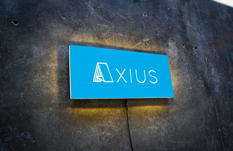 axius blue illuminated sign