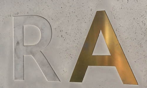 brass inlay letter on concrete