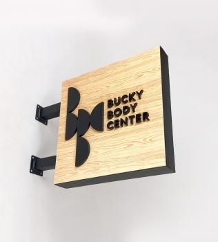 Bucky Body Center Blade Sign