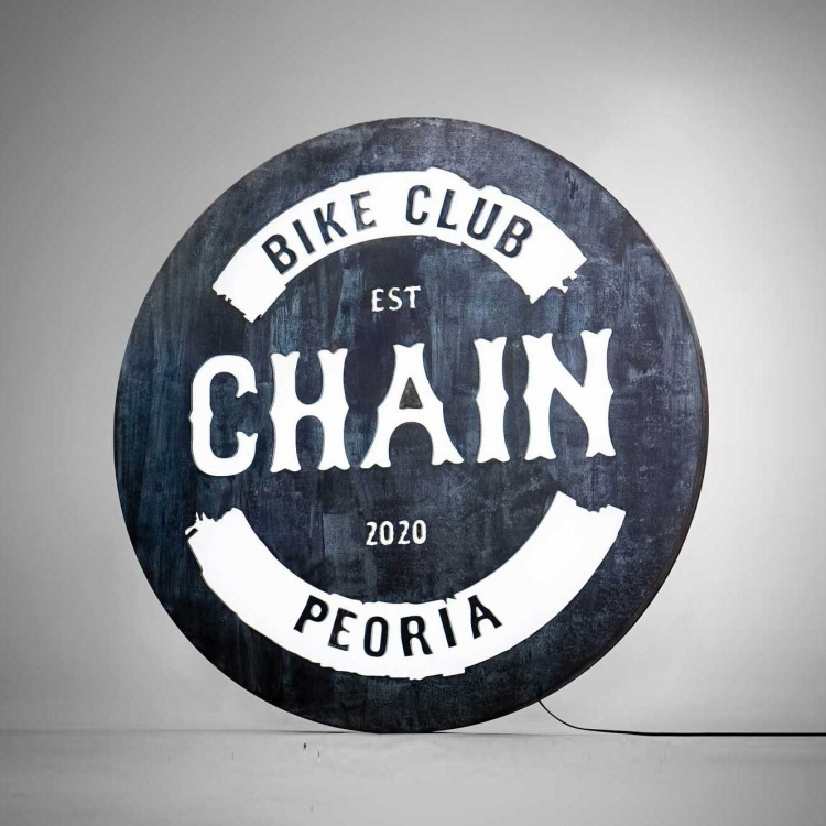 Faux rusty metal illuminated sign for Chain, a cycling studio in Styles Studios Fitness, a fitness club in Peoria, IL.