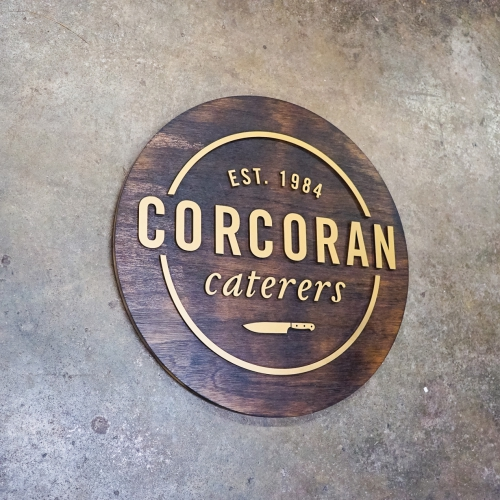 Rustic natural round raised torched wood and gold sign for Corcoran Caterers