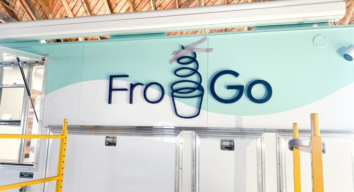 Illuminated, marquee-style sign on food truck for FroGo, a customizable, self-serve, dairy-free, frozen yogurt truck.
