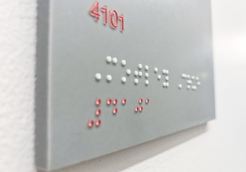 Grey and white meeting room ADA signs with Braille for the San Francisco office of Gong, a conversation intelligence platform for sales.