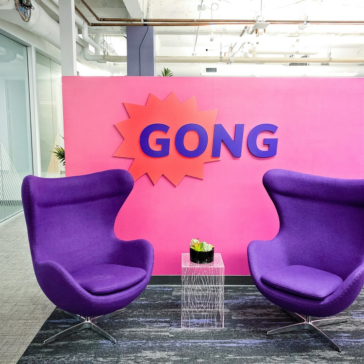 Red and purple painted sign for the San Francisco lobby of Gong, makers of a conversation intelligence platform for sales.