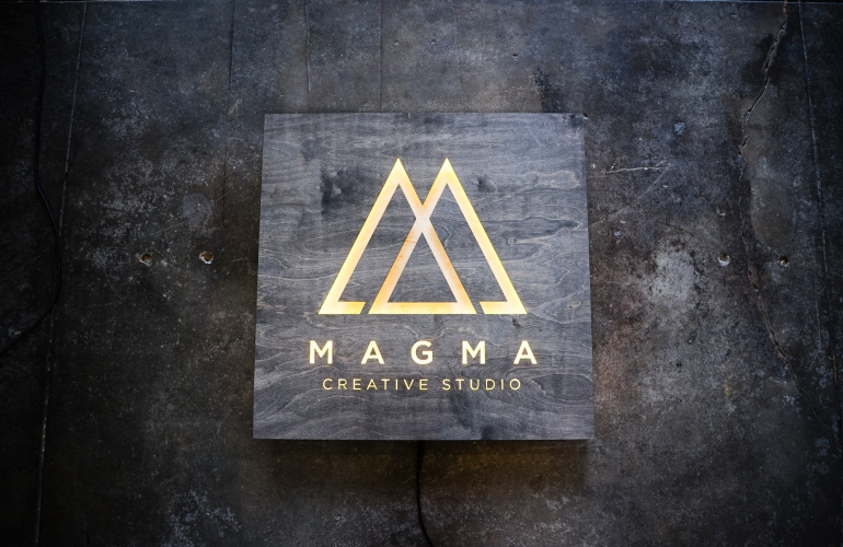 Illuminated, rustic-style, torched wood sign for Magma Creative Studio, a graphic design studio based in Roseville, California.