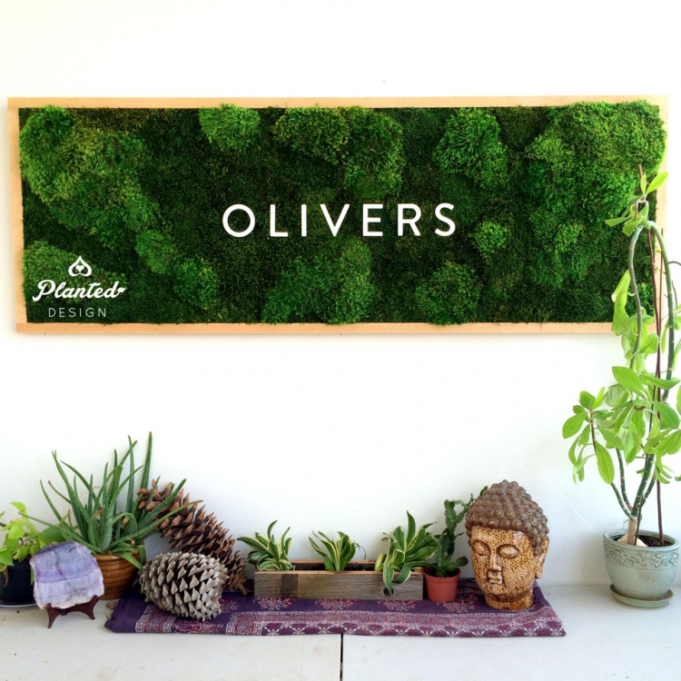 Framed rectangular moss sign with white text by Planted Design for Olivers