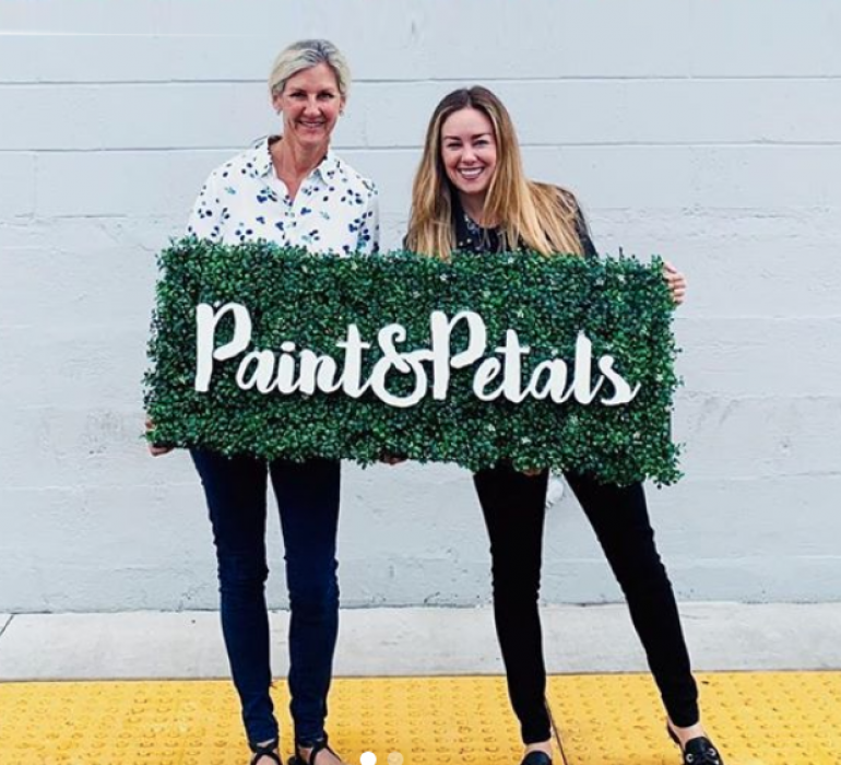 Faux boxwood sign with white script text for Paint & Petals, a California-based housewares collection created from Bridgette Thornton's hand-painted designs.