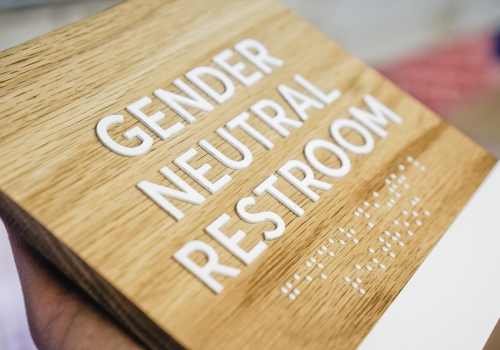 slack custom ada light wood restroom sign with braille