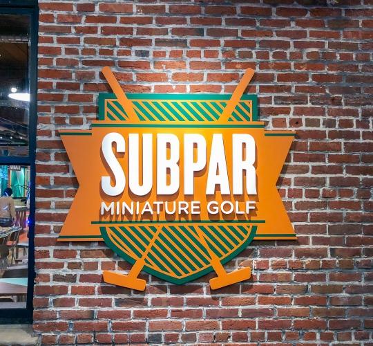 Subpar Mini Golf Exterior Wall Sign