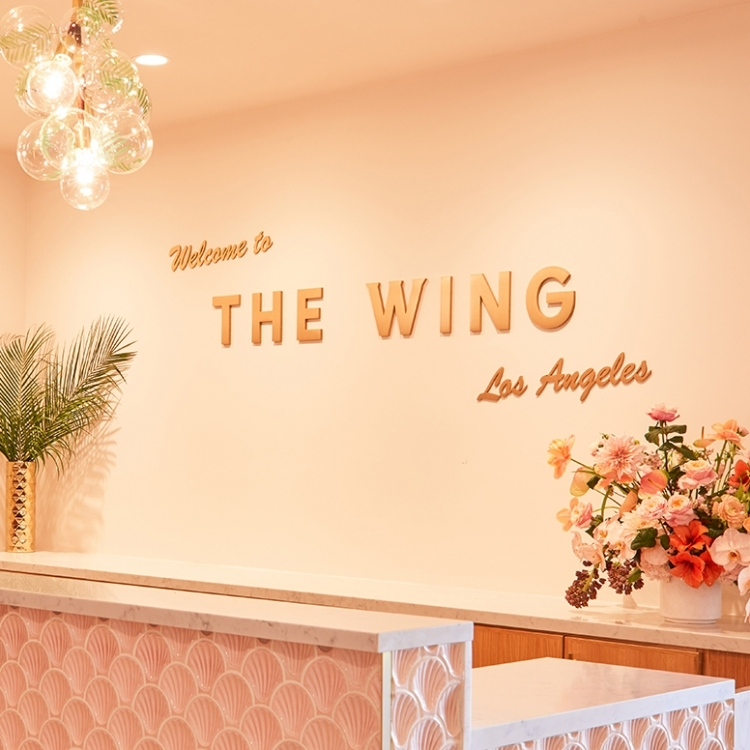 Retro, brass colored sign made from brushed, solid bronze for The Wing, a co-working space in Los Angeles.