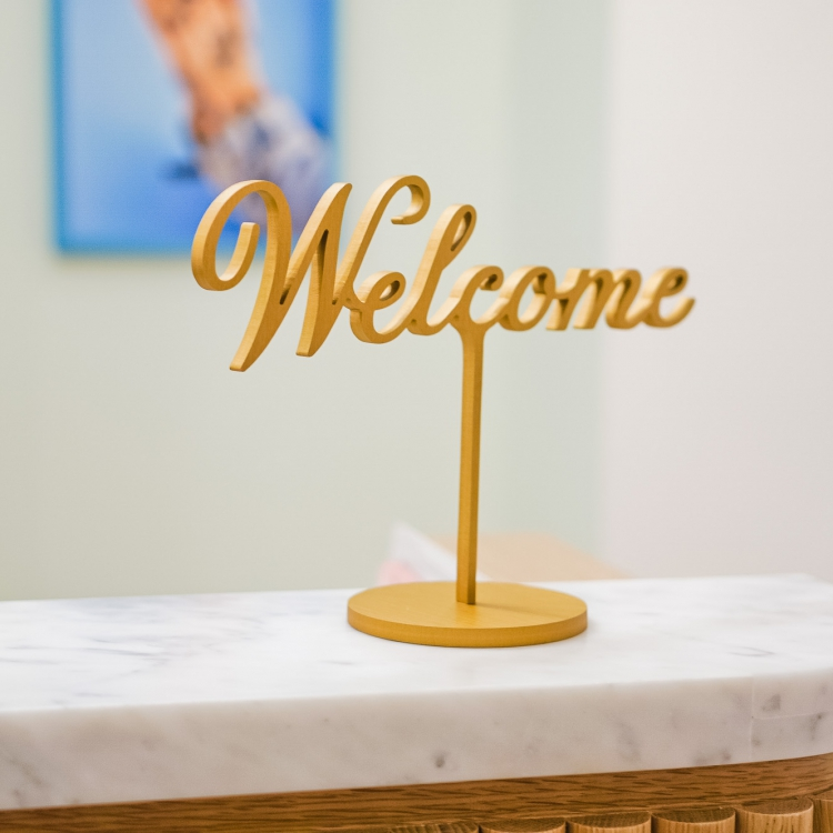Freestanding Welcome sign at the front desk of The Wing San Francisco, a co-working space for women.