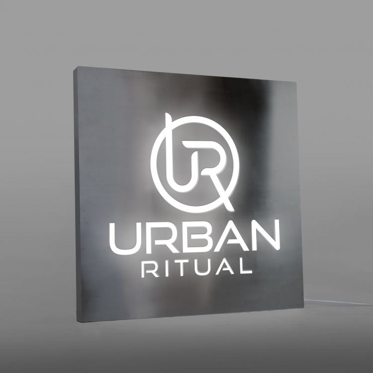 Brushed steel, interior-lit, large square wall sign for Urban Ritual, a fitness studio located in Styles Studios, a boutique fitness studio in Peoria, IL.